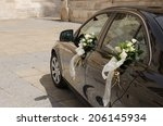 A Wedding Car Decorated With...