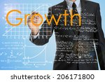 businessman writing growth and
