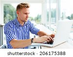 photo of a young man typing on... | Shutterstock . vector #206175388