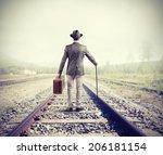 Businessman On Railway Walking...