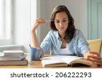 Teenage Girl Studying Reading...