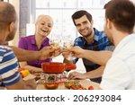 young friends having dinner... | Shutterstock . vector #206293084