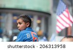 Small photo of NEW YORK CITY - JULY 20 2014: several thousand supporters of Israeli actions in Gaza staged a rally in Times Square. Boy wearing yarmulka with US flag in the background