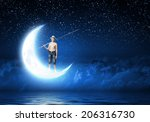 boy of school age with fishing... | Shutterstock . vector #206316730