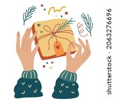 hands wrap a holiday gift.... | Shutterstock .eps vector #2063276696