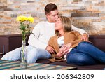 young couple at home  kissing  | Shutterstock . vector #206342809