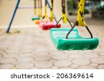 Colorful Swings And Rusty Iron...