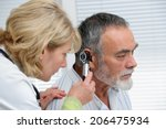 ent physician looking into... | Shutterstock . vector #206475934