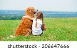 Little Girl Hugging Retriever...