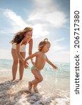 water running seaside family in ... | Shutterstock . vector #206717380