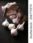 garlic in basket on black... | Shutterstock . vector #206775574
