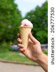 ice cream in hand outdoors | Shutterstock . vector #206777530