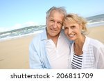 cheerful senior couple standing ... | Shutterstock . vector #206811709