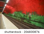 Small photo of STOCKHOLM, SWEDEN - JUNE 10, 2014: Solna Centrum metro station on June 10, 2014 in Stockholm, Sweden. This station was painted in 1975 by artists Anders Aberg and Karl-Olov Bjork.