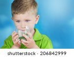 portrait of boy drinking glass... | Shutterstock . vector #206842999