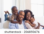happy family posing on the... | Shutterstock . vector #206850676