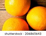 fresh orange on wood table desk ... | Shutterstock . vector #206865643