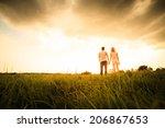 couple walking through the... | Shutterstock . vector #206867653