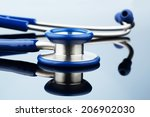 stethoscope against white... | Shutterstock . vector #206902030