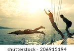 Stock photo silhouettes of children diving from the bow of a boat 206915194