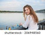 smiling teenager girl on the... | Shutterstock . vector #206948560