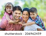 cute family portrait of 4 people | Shutterstock . vector #206962459
