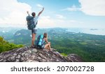 hikers standing on top of the... | Shutterstock . vector #207002728