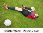 Football Player In Red Lying...