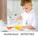 Little Boy Learning To Bake...