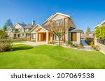luxury house at sunny day in... | Shutterstock . vector #207069538