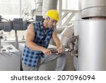 young manual worker using... | Shutterstock . vector #207096094