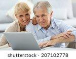 senior couple websurfing on... | Shutterstock . vector #207102778