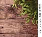 christmas twig on wooden... | Shutterstock . vector #207129196