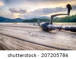 Fishing Tackle On A Wooden...