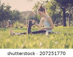 girl playing in the grass with... | Shutterstock . vector #207251770