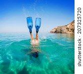 Women Snorkeling In Clear Wate...