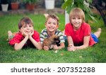young boys  hugging his dog | Shutterstock . vector #207352288