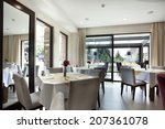 interior of a empty restaurant  | Shutterstock . vector #207361078
