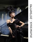 elegant lady in black dress... | Shutterstock . vector #207369790