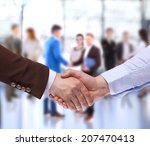 closeup of a business handshake | Shutterstock . vector #207470413