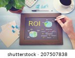 man drawing roi concept on... | Shutterstock . vector #207507838