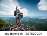 two hikers taking selfie on top ... | Shutterstock . vector #207527209