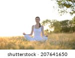 young beautiful woman practices ... | Shutterstock . vector #207641650