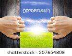 two hands opening old wooden... | Shutterstock . vector #207654808