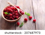 Ripe Sweet Raspberries In Bowl...