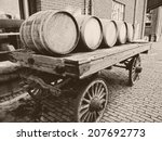 wooden barrels on an old... | Shutterstock . vector #207692773