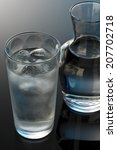 glass and bottle of water | Shutterstock . vector #207702718