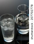 glass and bottle of water   Shutterstock . vector #207702778