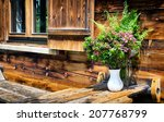 Wildflowers At A Log Cabin