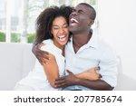 attractive couple cuddling on... | Shutterstock . vector #207785674